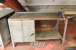 Solid heavy duty, metal work bench table 4 drawers 1 cupboard fixed with a vice